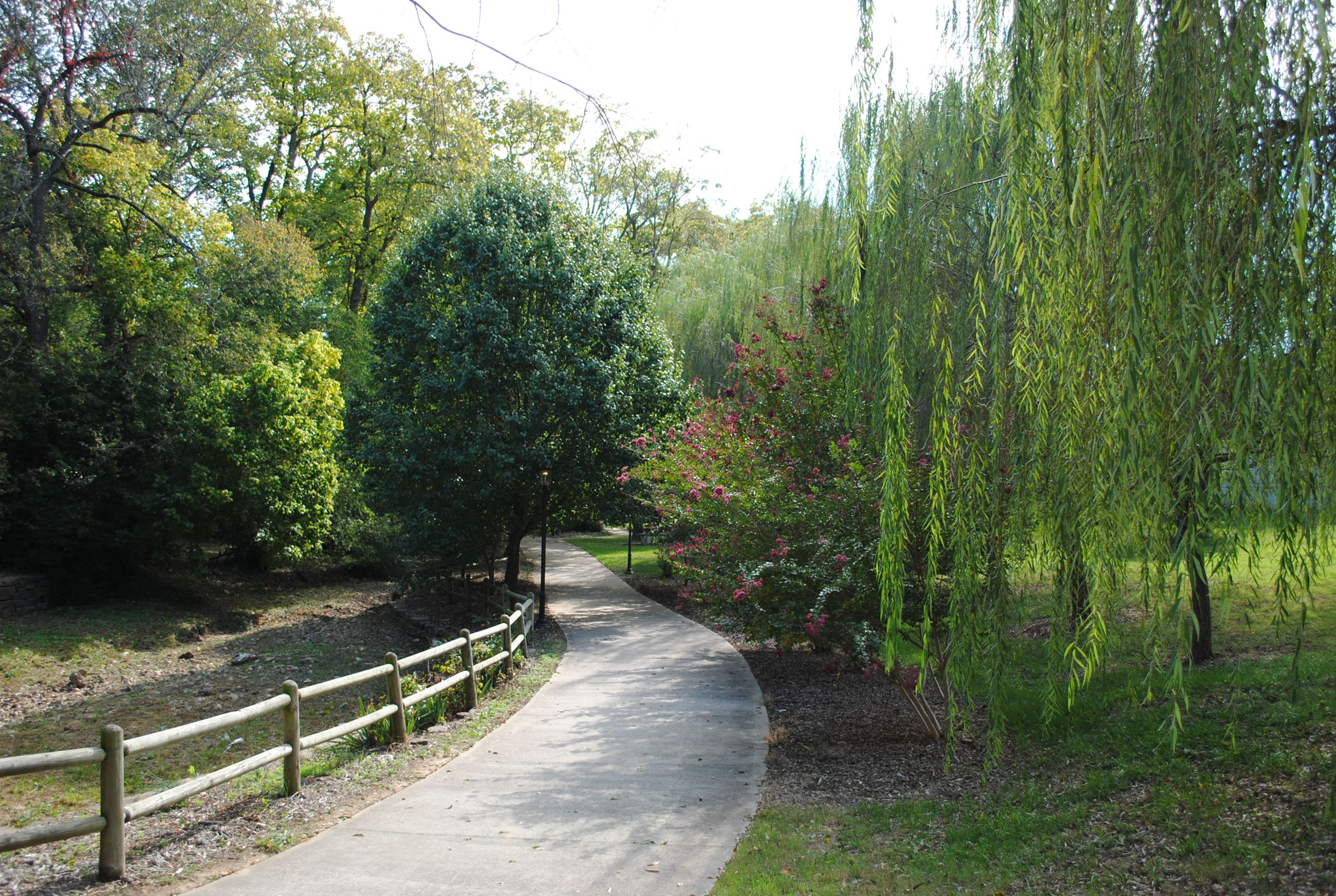 Town Branch Park image of tree lined paved sidewalk and fence