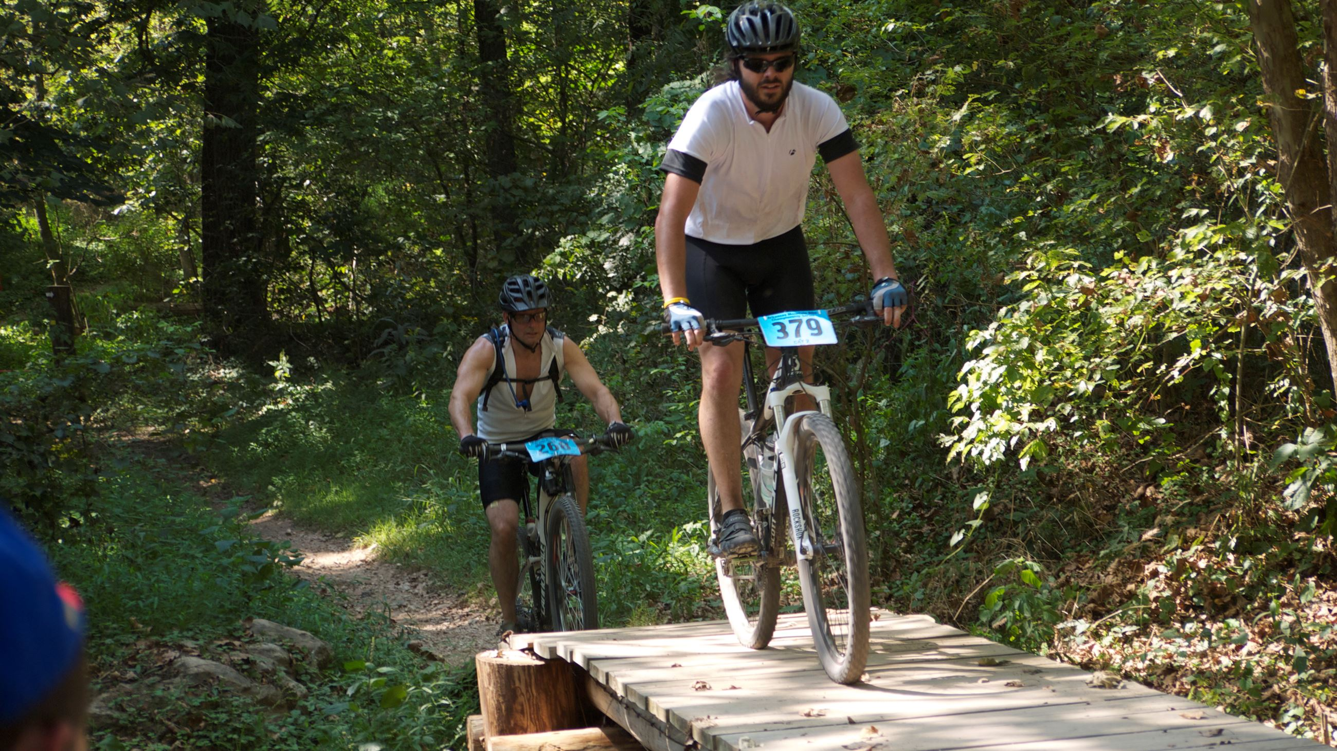 Slaughter Pen Mountain Bike Park Image of two bikers on wooden trail