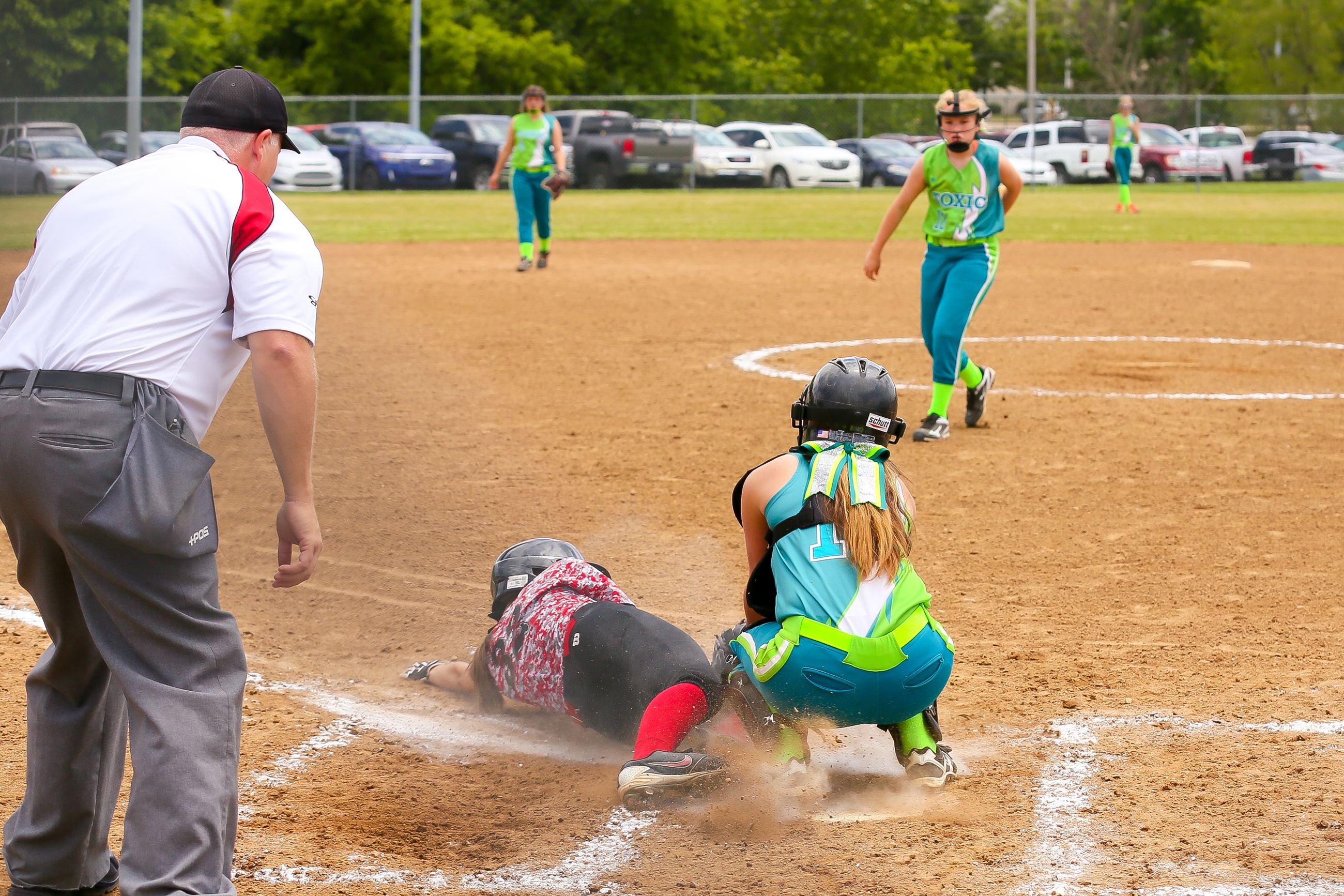 Image from home plate of girls softball game