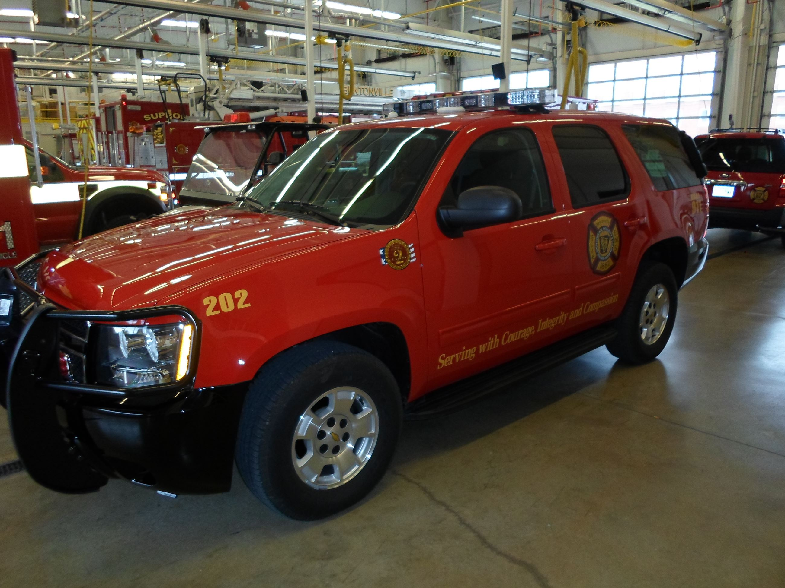 Command Vehicle Red SUV inside station