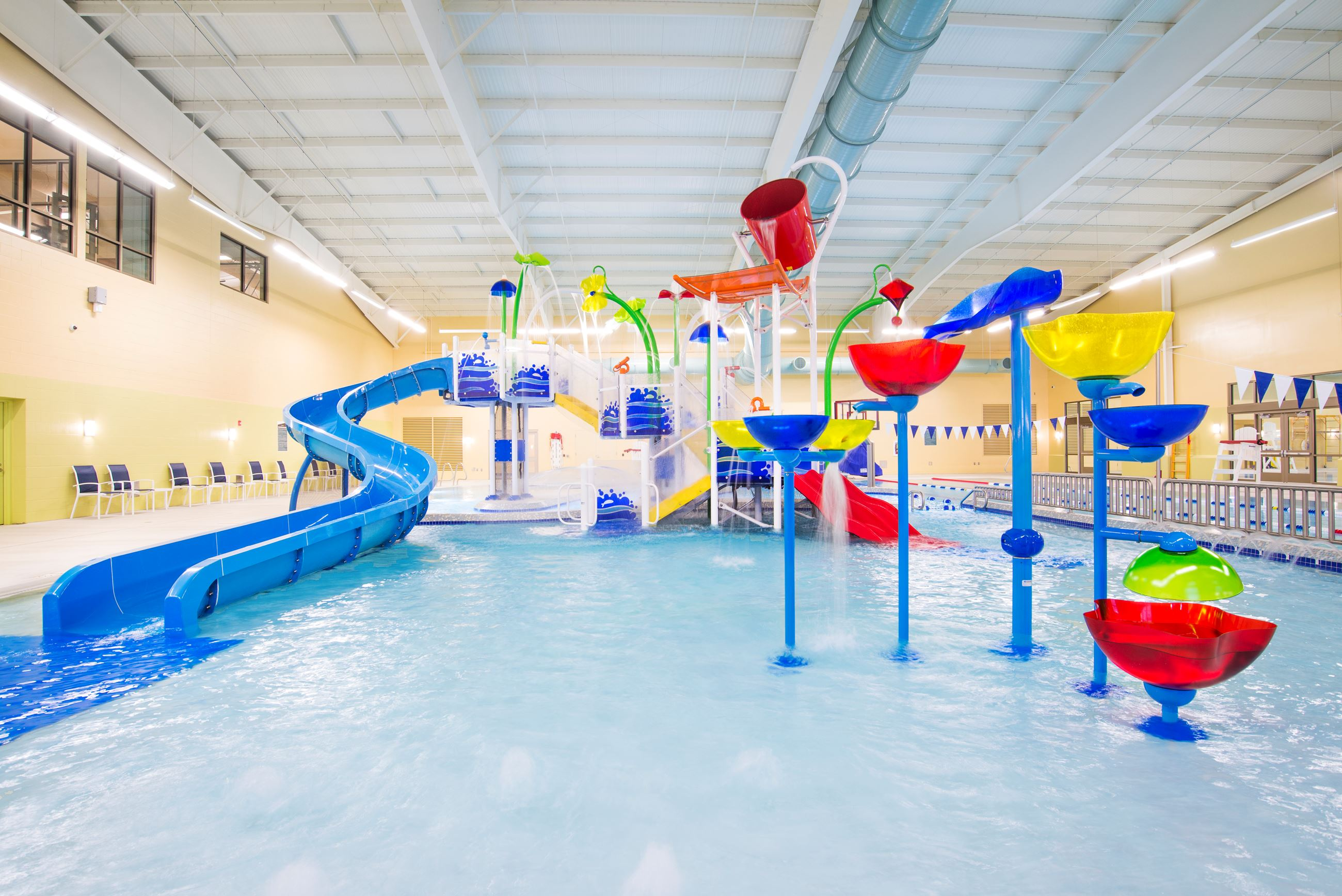 Image of an indoor pool with slides and play area